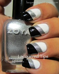 Black tips with silver stripes (by Lacquered Tips).  Base Coat: Seche Clear.  Polishes: Zoya Trixie, Wet N Wild Black Cream, & Essie Blanc.  Top Coat: Seche Vite