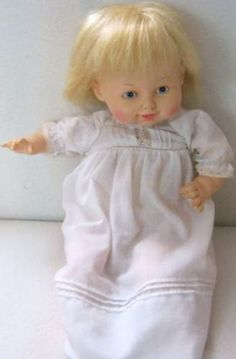 One of my very first baby dolls - 1976 Horsman talking happy baby doll. She let out a cry when you laid her down. Soft fabric body under dress.