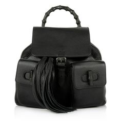 We are in love with the super cool backpack by Gucci 'Bamboo Leather Backpack Black'. Fashionette.com
