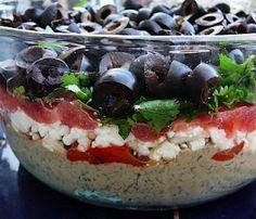 A tasty Mediterranean variation of the always popular Mexican layer dip!