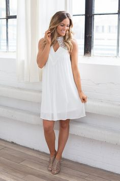 Calling all graduates and future brides! This white lace top keyhole dress is perfect for your next event. Fully lined. Polyester/Rayon blend. Dry clean only.Dress measurements from shoulder to hem: