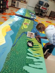 murals with children, student painted mural, school mural, river mural with kids