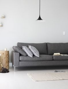 A sofa with coordinating cushions give a perfectly simple look.
