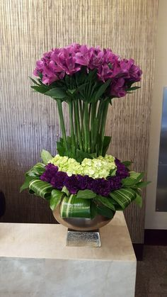 Topiary style with purple alstromeria, mini green hydrangea and novelty purple carnations