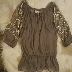 Holiday/New Years Eve Top Sequin cut out sleeves/ grey taupe color Sheer top comes with cami underneath  Size S Worn only for a few hours... like NEW! Brand is ECI New York Anthropologie Tops Blouses
