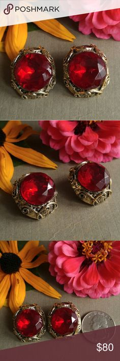 Vintage red stones clip earrings gold tone This elegant pair of vintage earrings has huge sparkly red faux ruby stones set in a high quality, weighty gold tone metal setting. Clip backs. Unsigned, but definitely high end costume jewelry. True vintage made before 1980s, most likely 1950s to 1960s. In very nice condition. From a smoke free home:) Vintage Jewelry Earrings