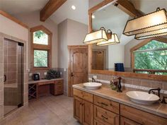 opposite these lovely sinks is a soaking tub with forest views. Realtor Websites, Forest View, Sinks, Tub, Bathrooms, Real Estate, Mirror, House, Furniture