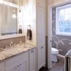 Vanity and linen tower traditional-bathroom