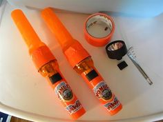 clear orange colored flashlights from dollar tree, tape together with orange duct tape.