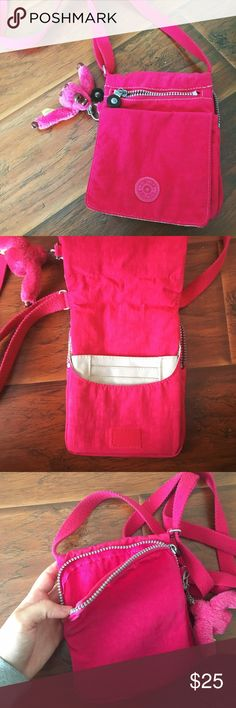 KIPLING Pink Crossbody Bag Gently worn a few times and its in almost perfect condition! The length of it is adjustable too! It has a bunch of pockets Kipling Bags Crossbody Bags