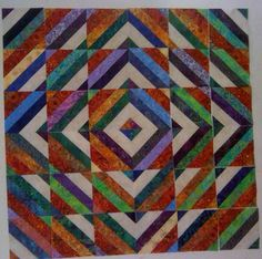 Great strip tube quilt.