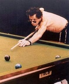 The famous rolling stone rock star Keith Richards playing pool