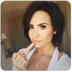Love Demi Lavato's short dark hair.. I want it  but i am too chicken to cut my long blonde hair short especially since im a new mom