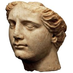 Ancient Roman Marble Head of Athena   From a unique collection of antique and modern antiquities at https://www.1stdibs.com/furniture/asian-art-furniture/antiquities/