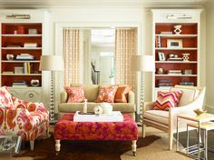 Upbeat geometric patterns accent a side chair and fan pleated drapery to play off the painted bookshelves. Image: Calicocorners.com