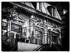 low angle view of windows of a old fashioned building. - Low angle black and white shot of old fashioned building with dormer windows.