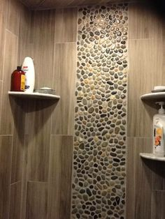 Stone mosaic on shower area wall. totally do-able!