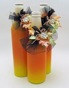 Upcycled glass bottles - painted to look like candy corn.  CUTE!