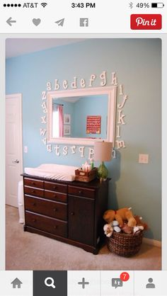 Love letters around mirror for nursery