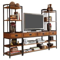 With plenty of space for framed photos, vases, and candles, this eye-catching entertainment center makes a lovely update in your den or living room. ...