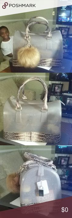 My baby just in today faux snake skin Furla Faux snake skin Furla candy bag she was so pretty wrapped I had to struggle with my self to unwrap her any way here she is she's not a  Dooney but still beautiful none the less bag from @kezanichole 10/20/2016 .handbag decor from @ certemt123 thanks ladies I love my purchases great sellers check them out ladies for great deals and customer service. Furla Bags