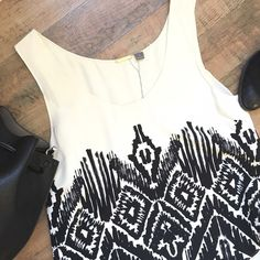 FOUNDRAE Layer Print Silk Tank SIZE: Euro 6  Tank style  Layered back  Scoop neckline  Hi-lo style  Cream and black  100% Silk  FRONT LENGTH: 33in BACK: 31in  RN#147904 🇨🇳    ☑️No Pets  ☑️Non-Smoking home  ☑️Every item steamed throughly before shipped!  💌 Ships from Santa Monica, CA   🗝Follow me on Instagram! @koukil1908 ask to have a video of the item ✌️ Foundrae Tops Tank Tops