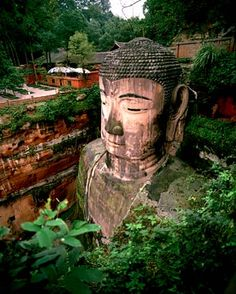 Leshan Giant Buddha, China  ( Abbeville Press )  The Leshan Giant Buddha in Sichuan was carved out of a mountainside in the 8th century. At 233 feet high, it is one of the largest images of the Buddha in the world.