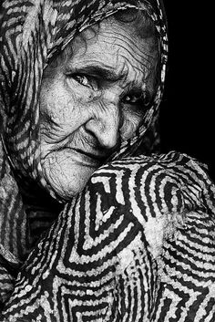 By Sergio Sergiopr. Woman, female, old lady, oldie, aged, worn out, portrait, powerful, wrinckles, old age, face, intense, photograph, photo b/w.