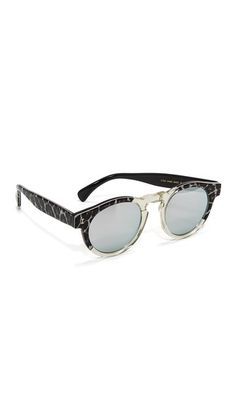 Illesteva sunglasses with animal-print frames and arms. Mirrored lenses. Hard case and soft pouch included.