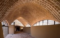 Mapungubwe Interpretation Center designed by South Africa's Peter Rich Architects. Designed as a low impact series of barrel and freeform vaults arranged in a triangular layout