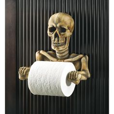 This bony fellow's grinning every time the paper's spinning. Spooky toilet paper holder is a most unexpected addition to your bathroom; a daring decorator's dream come true! Weight 1.7 lbs. Polyresin. Toilet paper not included. 8-1/4 x 4-1/2 x 8-3/8 high.