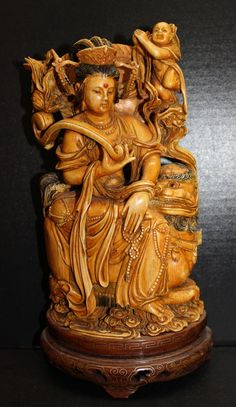 "Impressive Chinese Finely Carved Ivory Group. Quan Yen group over foo dog. Measures - 10"" high."