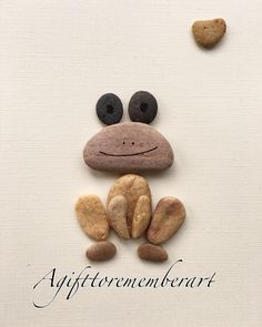 """Little pebble frog"" #agifttorememberart #pebbleart #frog #instaart #instaphoto #instagood #handmade #handmadecards #gift #makersgonnamake #etsy #etsyseller #australia #beach #roomdecor #madebyme #ocean #greetingcards #cute #unique #stones #nature #instanature #animals"
