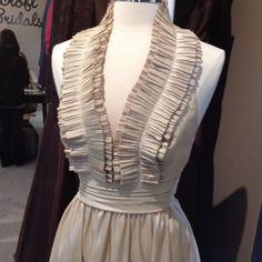Halter dress with a ruffled neckline