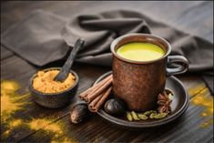 Hunt through your spice rack and dig out turmeric to make this warming, caffeine-free tea. This golden spice is popping up on menus everywhere and is taking the world over with its countless health benefits. Turmeric And Pepper, Turmeric Drink, Organic Turmeric, Ayurveda, Turmeric For Arthritis, Golden Milk Benefits, Indian Drinks, Milk Ingredients, Stock Image
