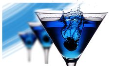 Blue Cosmo #Cocktails  2 oz Absolut® Citron vodka  1 maraschino cherry  1 oz Blue Curacao liqueur  1/2 oz grapefruit juice  1/2 oz sugar syrup  sugar    Frost the rim of a chilled cocktail glass with sugar. Stir absolut citron, blue curacao, grapefruit juice, and sugar syrup in a mixing glass with ice to prevent cloudiness. Strain into cocktail glass. Garnish with a maraschino cherry.