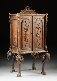 AN UNUSUAL CONTINENTAL CARVED WALNUT MUSIC CABINET, : Lot 528