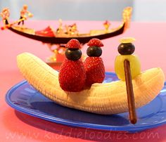 Banana gondola with two strawberry fellows and a grape gondolier