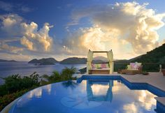 This pool is the azure jewel of a villa that overlooks neighboring islands in the Caribbean.