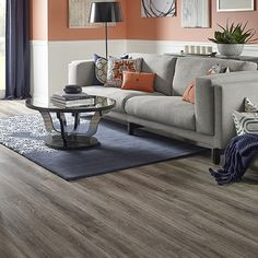 Heathered Oak textured laminate floor. Medium oak wood finish, 12mm 1-strip plank laminate flooring, easy to install and covered by PERGO's lifetime warranty.  Lowes