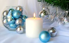 White Christmas Candle with Blue and Silver Decorations