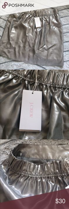 NWT! J.Crew 100% Silk Metallic Skirt Gorgeous! Size Small/Size 2. It can honestly fit any Small! I have this in a size 8 and got so many compliments on it! Paired it with a white Bodysuit. Silvery soft and 100% all silk! So gorgeous. Bought this for my sister and it didn't fit. Never worn tags still on. J. Crew Skirts Mini