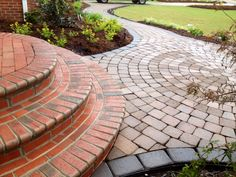 I don't like this mixed stone combination, but here is an example of rounded steps meeting rounded pavers that we can use for future reference.