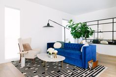 Blue velvet Tufted Sofa with an Oval Marble and Brass Cocktail table - Contemporary - Living Room Blue Velvet Sofa Living Room, Blue Couches, Rugs In Living Room, Living Room Decor, Eclectic Living Room, Living Room Modern, Living Room Designs, Living Spaces, Sofa Design
