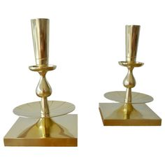 Pair of Tommi Parzinger Candle Holders by Dorlyn Silversmiths | From a unique collection of antique and modern candle holders at https://www.1stdibs.com/furniture/decorative-objects/candle-holders/