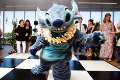 Stitch character appearance at Disney Fairy Tale Wedding reception inside Epcot's GM Lounge