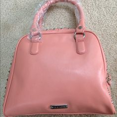 Steve Madden Salmon Studded Satchel Steve Madden Studded Satchel in salmon color, faux leather, silver hardware, zip top, brand new with tags.  Originally $128. Please let me know if you have any questions, thanks for looking! Steve Madden Bags Satchels