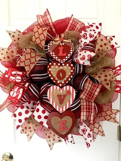 Happy Valentines Day!!! Love is in the air and on this wreath! The beautiful sign is very detailed with burlap, adorable buttons and gingham bows! It measures 24x7 deep and contains 4 different decomesh colors (black, red, burlap and red and white striped. The ribbons are adorable!!! Burlap polka dots, red and white love, hearts, plaid make this wreath stand out