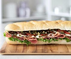 New Orleans-Style Muffuletta Olive salad -- piled onto ciabatta with layers of Italian meats and cheeses -- distinguishes this sandwich from an ordinary sub.