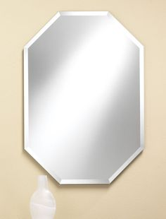 314 – Octagon frameless mirror features 1″ beveled edge. 24″ wide, 32″ high and 3/8″ deep.
